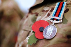 A soldier proudly wears his Remembrance Day Poppy alongside his Afghanistan Medal Source: Wikimedia Commons